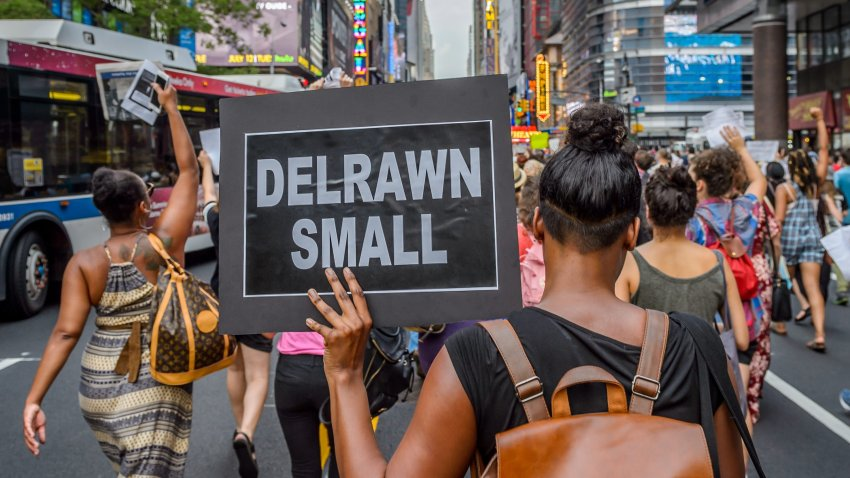 About two thousand New Yorkers marched in Manhattan bringing traffic to a halt for many hours demanding police accountability and to remember Delrawn Small