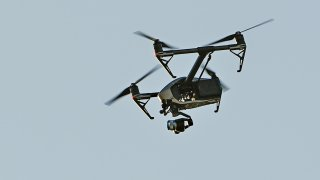 A DJI Inspire drone is flying in the air.