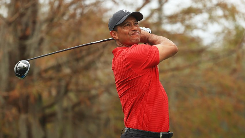 ORLANDO, FLORIDA - DECEMBER 20: Tiger Woods of the United States plays his shot from the ninth tee during the final round of the PNC Championship at the Ritz-Carlton Golf Club Orlando on December 20, 2020 in Orlando, Florida.