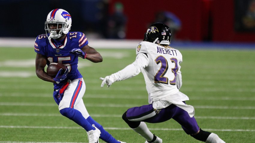 John Brown #15 of the Buffalo Bills runs with the ball after a catch in the fourth quarter against Anthony Averett #23 of the Baltimore Ravens