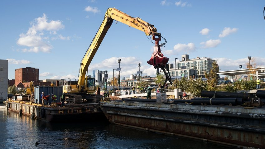 A work crew contracted by the Environmental Protection Agency removes debris from the Gowanus Canal