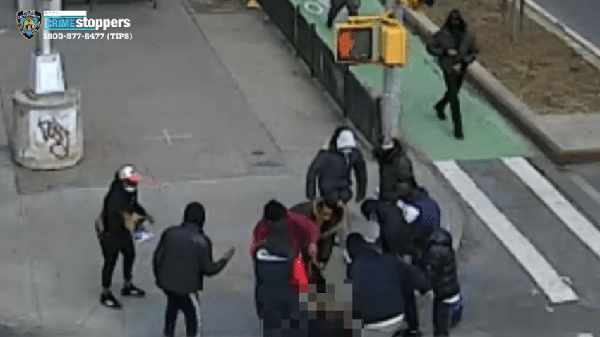 A group of males and females assaulted the victim at about 11:30 a.m. Friday near Canal and Allen streets in Manhattan, city police said
