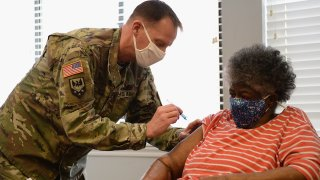 In this Feb. 11, 2021, file photo, Staff Sergeant Herbert Lins of the Missouri Army National Guard administers the COVID-19 vaccine to a resident during a vaccination event at the Jeff Vander Lou Senior living facility in St Louis, Missouri.