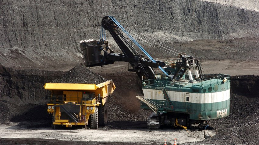 FILE - In this April 4, 2013, file photo, a mechanized shovel loads a haul truck that can carry up to 250 tons of coal at the Spring Creek coal mine near Decker, Mont. The Trump administration says the resumption of coal sales from public lands will result in a negligible increase in greenhouse gas emissions, but critics say that ignores the federal coal programs broader impacts.