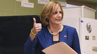 Republican Congresswoman Claudia Tenney signals she successfully cast her ballot after voting at St. George's Church