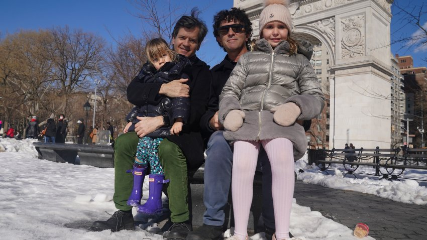 New York State Senator Brad Hoylman, left, with his husband David Sigal, right, pose with their daughters