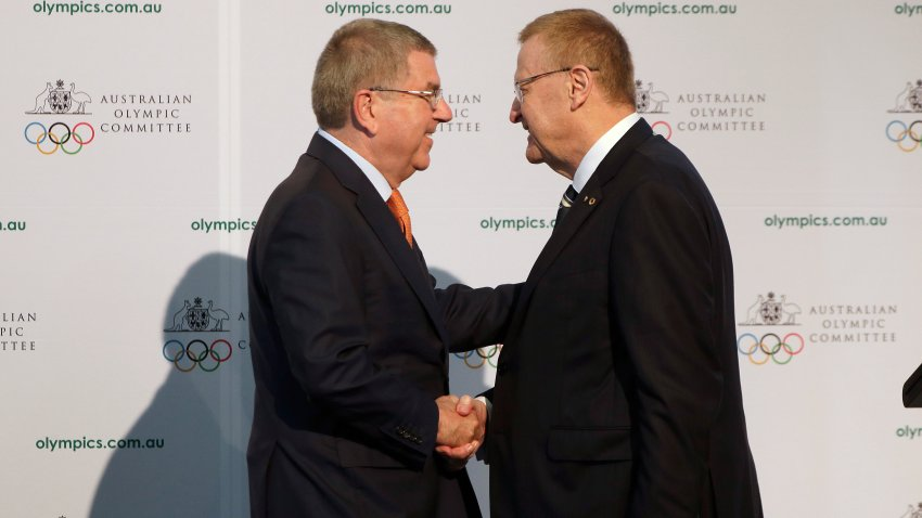 "FILE - In this Saturday, May 4, 2019 file photo, International Olympic Committee President Thomas Bach, left, shakes hands with Australian Olympic Committee (AOC) President John Coates at the AOC annual general meeting in Sydney, Australia. The Australian Olympic bid is on a fast-track to host the 2032 Olympics Wednesday Feb. 24, 2021, after the International Olympic Committee executive board gave Queensland ""preferred bidder"" status, 11 years ahead of the games."