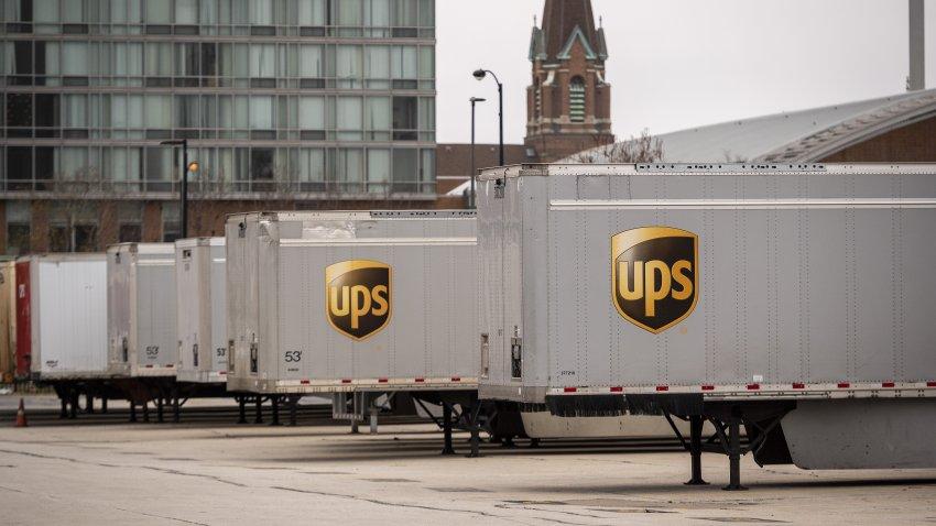 A United Parcel Service Inc. (UPS) trucks outside a distribution center in Chicago