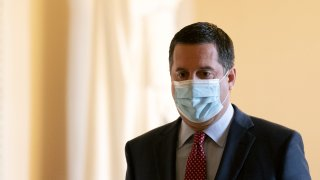 Representative Devin Nunes, a Republican from California, wears a protective mask while walking through the U.S. Capitol in Washington, D.C., U.S. on Monday, Jan. 4, 2021. The non-stop drama of 2020 is bleeding into the first week of the new year, with a pivotal election in Georgia, promises of protests in the streets and President Trump's dragged-out fight over the November vote threatening to tear apart the Republican Party.
