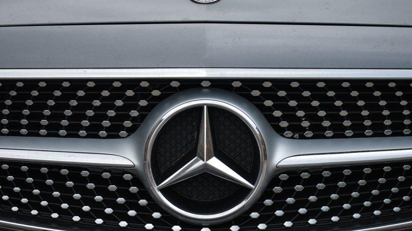 a logo of Mercedes-Benz