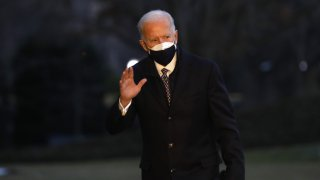 U.S. President Joe Biden walks on the South Lawn of the White House after arriving on Marine One in Washington, D.C., U.S., on Friday, Feb. 19, 2021. Biden traveled to the Michigan plant wherePfizer Inc.is manufacturing its Covid-19 vaccine as his administration works to boost the number of shots delivered each day.