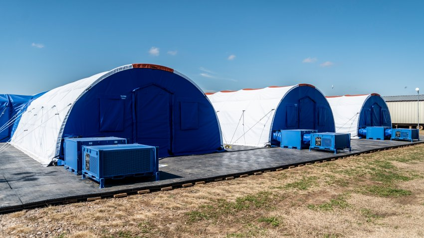 Intensive care tents sit in a row at a Influx Care Facility (ICF) for unaccompanied children on Sunday, Feb. 21, 2021 in Carrizo Springs, TX.