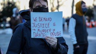 protester holds Daniel Prude sign