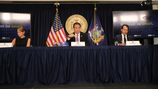 New York state Gov. Andrew Cuomo, flanked by Melissa DeRosa, secretary to the governor; and state Budget Director Robert Mujica, speaks at a news conference on September 08, 2020 in New York City