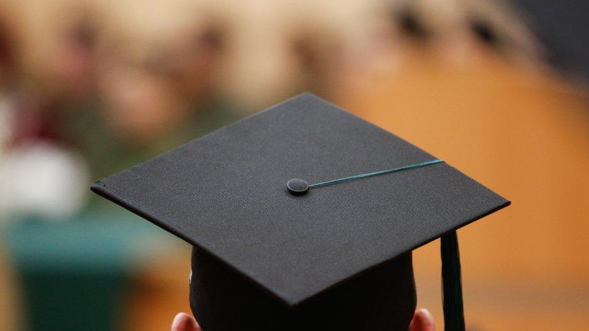 a graduate wearing a graduation cap