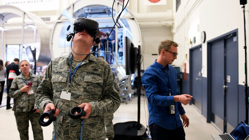 Chief Master Sgt. Marty Rush, Air Force Space Command Public Affairs chief enlisted manager at Peterson Air Force Base working in virtual reality at the Digital Twin Demo with NextSTEP Lunar Habitat at the Lockheed Martin Space Waterton Facility. April 16, 2018 Littleton, CO