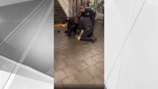 Police restraining suspect