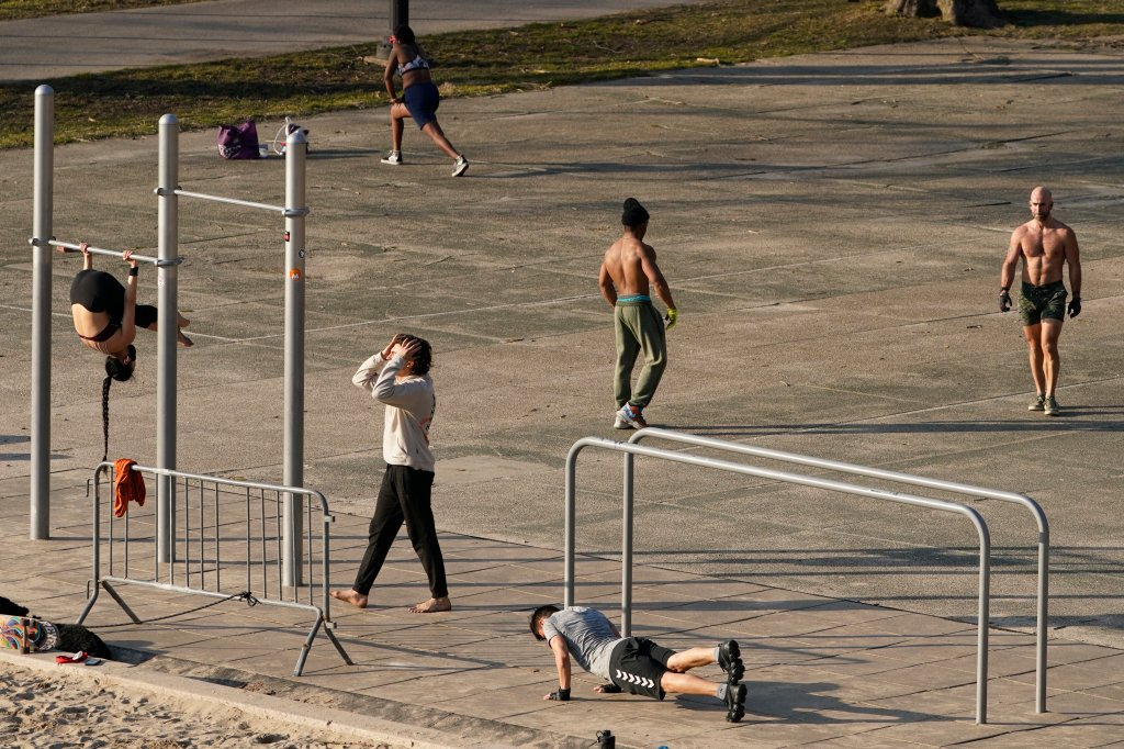 People exercise outside on a warm day in New York