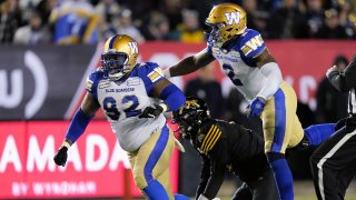 CALGARY, AB - NOVEMBER 24: Drake Nevis #92 and Jonathan Kongbo #2 of the Winnipeg Blue Bombers celebrate a sack of Dane Evans #9 of the Hamilton Tiger-Cats at McMahon Stadium on November 24, 2019 in Calgary, Canada. Winnipeg Blue Bombers defeated the Hamilton Tiger-Cats 33-12 in the 107th Grey Cup.