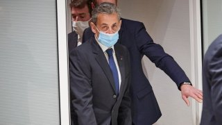 In this March 1, 2021, file photo, former French President Nicolas Sarkozy leaves court after being found guilty of corruption and influence-peddling in Paris, France.