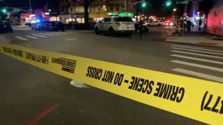 Police taped off the street where a 37-year-old woman was struck in the head and later died, the NYPD said Saturday