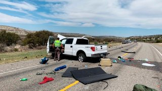Debris is strewn across a road near the border city of Del Rio, Texas after a collision Monday, March 15, 2021.