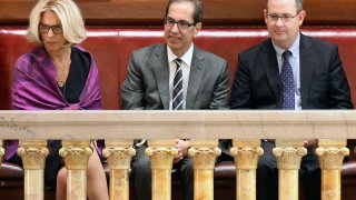 Janet DiFiore, chief judge of the New York Court of Appeals, left, sits with newly confirmed Associate Judge Paul Feinman, center, and his husband Robert Ostergaard, right, in the Senate gallery after being confirmed by the Senate, in Albany, New York, June 21, 2017.
