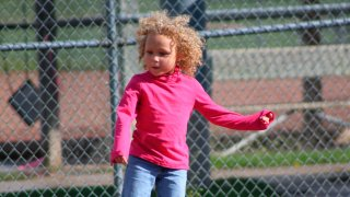Jurnee Hoffmeyer, 7, seen here before a classmate and a teacher cut her hair on separate occasions.