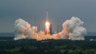 In this April 29, 2021, file photo released by China's Xinhua News Agency, a Long March 5B rocket carrying a module for a Chinese space station lifts off from the Wenchang Spacecraft Launch Site in Wenchang in southern China's Hainan Province.