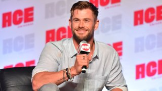 In a Sunday, Oct. 13, 2019 file photo, Chris Hemsworth participates during a Q&A panel on day three at the Ace Comic-Con in Rosemont, Ill. Elton John and Chris Hemsworth are among the celebrities donating big bucks to help aid the efforts for the engulfing wildfires in Australia.
