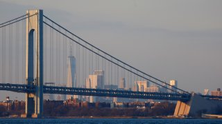 The Verrazzano-Narrows Bridge sits in front of One World Trade Center