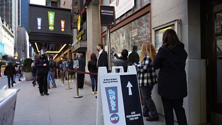 Attendees wait in line as Broadway's St. James Theatre reopens with an exclusive performance for frontline workers as part of NY PopsUp on April 03, 2021 in New York City
