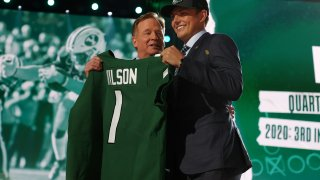 Zach Wilson with Roger Goodell after being drafted