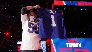 Giants Fan holding Kadarius Toney jersey