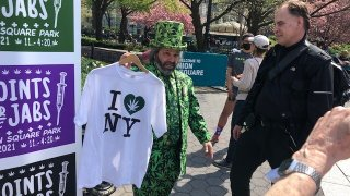 """Man in marijuana suit at """"Jabs for Joints"""" event"""