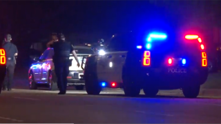 3 Police cars with red and blue lights on late at night