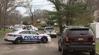 Suffolk County Police cars at scene