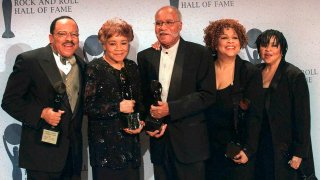 CORRECTS SINGING GROUP TO THE STAPLE SINGERS - FILE - This March 15, 1999 file photo shows the sibling group The Staple Singers, from left, Pervis, Cleotha, Pops, Mavis, and Yvonne at the Rock and Roll Hall of Fame induction ceremony in New York. Yvonne Staples, whose voice and business acumen powered the success of her family's Staples Singers gospel group, has died at age 80. The Chicago funeral home Leak and Sons says that she died Tuesday, April 10, 2018 at home in Chicago.