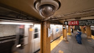 FILE - In this Oct. 7, 2020, file photo, a video surveillance camera is installed on the ceiling above a subway platform in the Court Street station in the Brooklyn borough of New York. State lawmakers across the U.S. are reconsidering the tradeoffs of facial recognition technology amid civil rights and racial bias concerns.