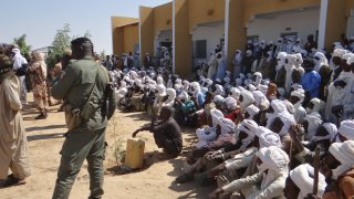 Security forces take measures as people wait to get tested for coronavirus (COVID-19) in Chad's capital and largest city N'Djamena as daily life continues in crowded areas amid the COVID-19 pandemic, on December 27, 2020.