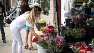 People buy flowers in Hoboken of New Jersey, United States on May 9, 2021 as Mother's Day is celebrated cross country.