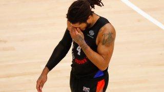 Derrick Rose walks off court
