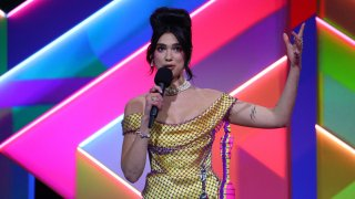 Dua Lipa wins the Female Solo Artist award during The BRIT Awards 2021 at The O2 Arena on May 11, 2021 in London, England.