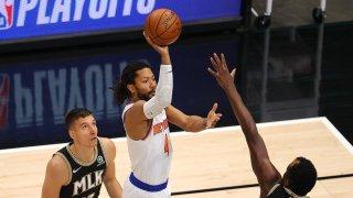 Taj Gibson #67 of the New York Knicks steals the ball from Bogdan Bogdanovic #13 of the Atlanta Hawks