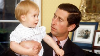 Prince Charles with Prince Harry at age one