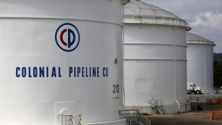 Storage tanks stand at the Colonial Pipeline Co. Pelham junction and tank farm in Pelham, Alabama