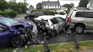 Cars on a street in Hempstead were seriously damaged in the aftermath of a deadly crash Saturday.