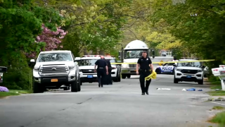 Police in Suffolk County tape off a residential street after the death of a 3-year-old boy struck by a pickup truck pulling out of a driveway.