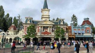 Visitors wait to enter Disneyland Paris