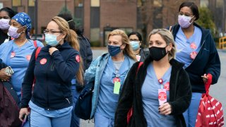 Nurses walk out of Montefiore New Rochelle Hospital to go on strike over safe staffing issues during the coronavirus pandemic, Tuesday, Dec. 1, 2020, in New Rochelle, N.Y.
